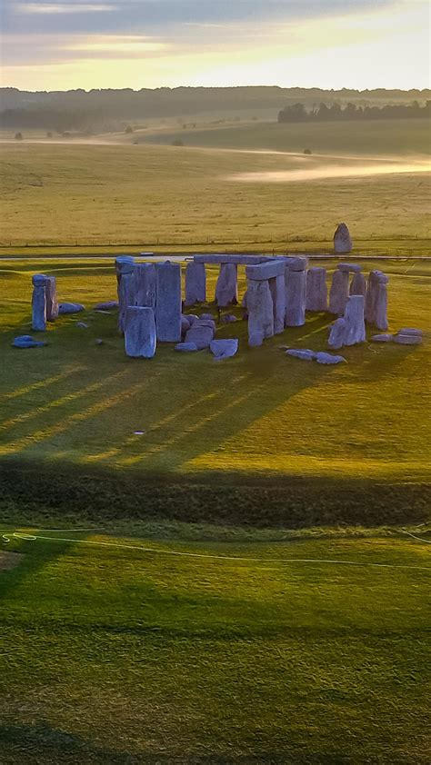 Long shadows from the early morning sun at Stonehenge